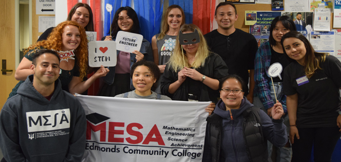 EDCC students holding a MESA banner