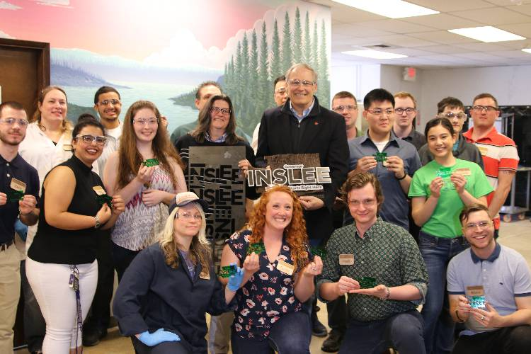 Edmonds CC students present Gov. Inslee with a laser-cut souvenir that was designed and made in the college's Rapid Proto Lab.