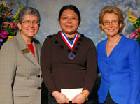 Siyu Lu (center) at the All-Washington Academic Team ceremony with Edmonds Community College President Jean Hernandez and Washington State Gov. Chris Gregoire.
