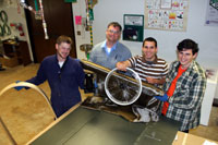 Left to right: Materials science students Evan Stark, Rick Stilwell, Augusto Dolce, and David Faulds with some of the space age materials, including a fabric made out of volcanic rock, they are using to build a gravity powered car.