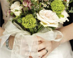 bride holding flowers