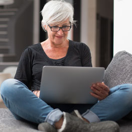 Woman sitting on the floor using a laptop