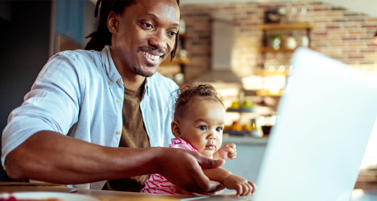 Father and baby using a laptop