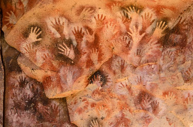 Image of handprints on cave wall