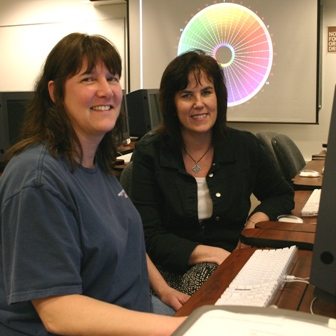 Two women students in a computer lab